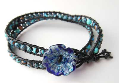 Bracelet, double, 4mm blue Calsilica, black/ Unicorn glass button